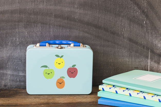 lunchbox-near-stack-notebooks_23-2147866252 (1)