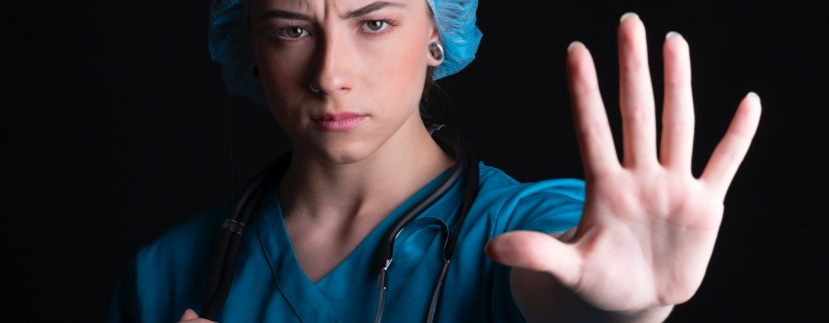 Young female doctor gesturing